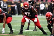 Louisville offensive lineman Mekhi Becton (73) in action during the first half of an NCAA college football game in Louisville, Ky., Saturday, Oct. 26, 2019. (AP Photo/Timothy D. Easley)
