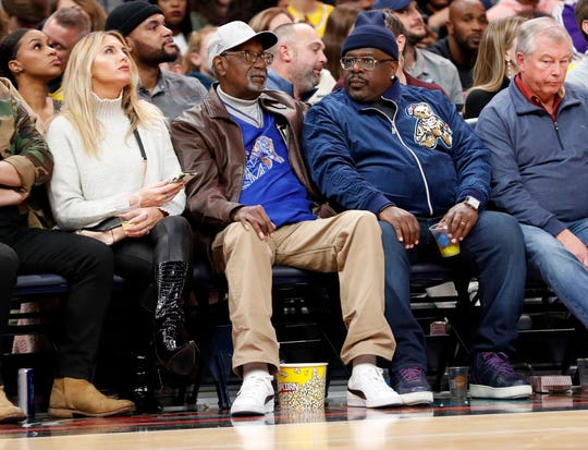 Cedric the Entertainer watches the game from the front row Saturday, Nov. 23, 2019, during a game at FedExForum in downtown Memphis. The Lakers defeated the Grizzlies 109-108.