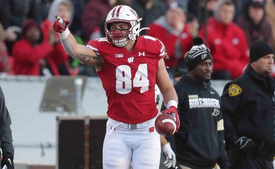 Wisconsin Badgers tight end Jake Ferguson signals a first down after his catch against Purdue on Nov. 23.