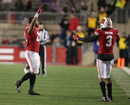 Badgers running back Jonathan Taylor  acknowledges the crowd Saturday.