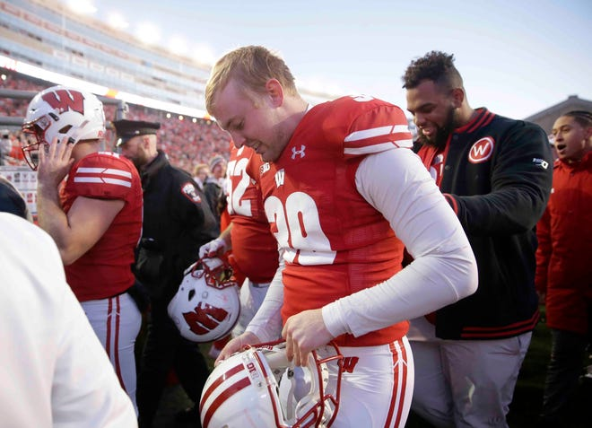 Wisconsin place kicker Zach Hintze is all smiles after hitting a 62-yard field goal at the end of the first half Saturday.