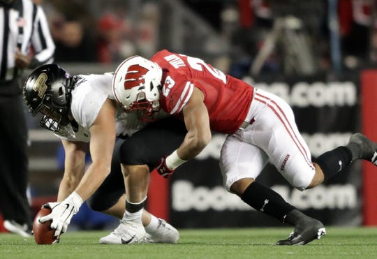 Purdue defensive end George Karlaftis recovers a fumble by Wisconsin running back Jonathan Taylor on Saturday