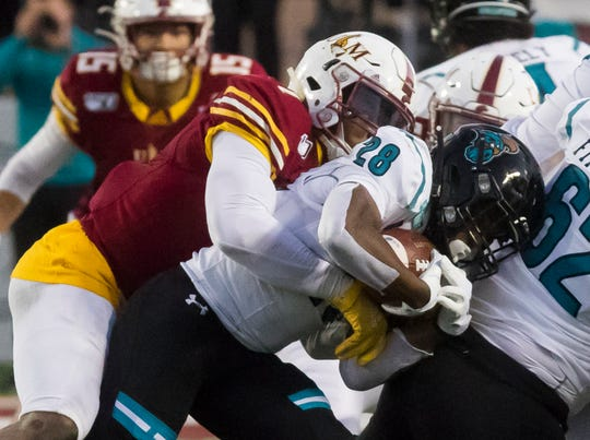 ULM defeated Coastal Carolina 45-42 on Saturday at JPS Field at Malone Stadium to get within one game of bowl eligibility.