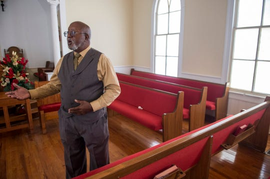 Rev. Willie Smith talks at the New Salem Christian Church in Hayneville, Ala., on Sunday, Nov. 24, 2019. Lowndes County Sheriff John Williams was shot and killed Saturday night.