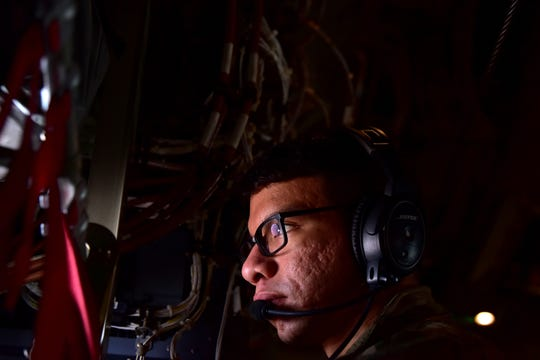 U.S. Air Force Airman 1st Class Cesar Salas Morales, 41st Airlift Squadron loadmaster, observes take-off in a C-130J Super Hercules during the ROCKI 20-01 dispersed basing scenario over Pope Field, North Carolina, Nov. 16, 2019.