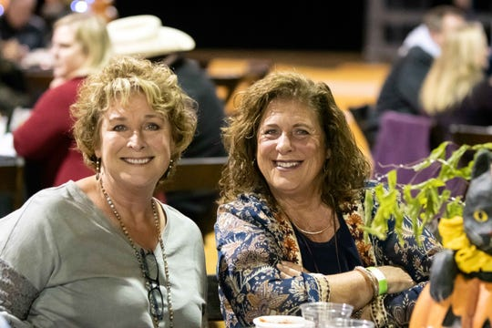 Knoxye Williams and Susan Wainright listen to the band Trotline after dining in MANE's Poarch Creek Arena.