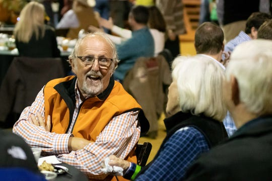 Long-time MANE supporter Frank Putz relaxes with friends at Raise the Roof.