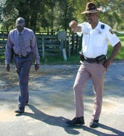 File photo shows then chief deputy John Williams, right, at the intersection where Williams apprehended Jamil Abdullah Al-Amin.