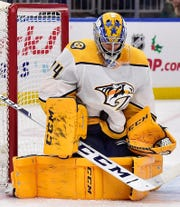 Nashville Predators goaltender Juuse Saros (74) makes a save during the second period against the St. Louis Blues at Enterprise Center.