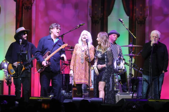 """Robbie Robertson, center left, performs during """"The Last Waltz Nashville: An All-Star Celebration of The Band's Historic Farewell Concert"""" at Bridgestone Arena Saturday, November 23, 2019."""