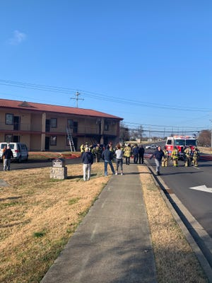 Two people escaped a fire inside their room at the Jackson Motel on Northwest Broad Street Sunday morning.