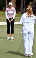 Brooke Henderson lines up her putt with caddie and sister Brittany Henderson during the 2019 CME Group Tour Championship at the Tiburón Golf Club in Naples, Saturday, Nov. 23, 2019.
