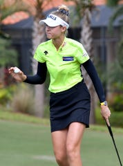 Nelly Korda waves after she sinks a putt on green on 6th hole during the 2019 CME Group Tour Championship at the Tiburón Golf Club in Naples, Saturday, Nov. 23, 2019.