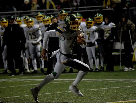 Newark Catholic senior Matt Carlisle scrambles for a first-half touchdown Saturday during the Green Wave's 22-15 loss to Harvest Prep in a Division VII, Region 27 final at Westerville Central.
