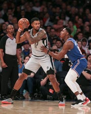 Nov 23, 2019; New York, NY, USA; San Antonio Spurs forward Rudy Gay (22) protects the ball from New York Knicks forward RJ Barrett (9) during the first quarter at Madison Square Garden.