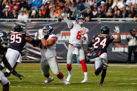 New York Giants quarterback Daniel Jones (8) throws against the Chicago Bears during the first half of an NFL football game in Chicago, Sunday, Nov. 24, 2019. (AP Photo/Charles Rex Arbogast)