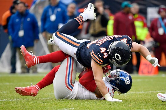 Nov 24, 2019; Chicago, IL, USA; Chicago Bears inside linebacker Nick Kwiatkoski (44) tackles New York Giants wide receiver Sterling Shepard (87) in the second half at Soldier Field. Mandatory Credit: Quinn Harris-USA TODAY Sports