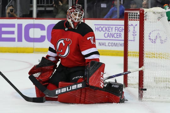 Nov 23, 2019; Newark, NJ, USA; New Jersey Devils goaltender Louis Domingue (70) makes a save during the first period of their game against the Detroit Red Wings at Prudential Center.