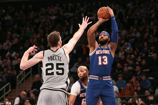 Nov 23, 2019; New York, NY, USA; New York Knicks forward Marcus Morris Sr. (13) shoots the ball as San Antonio Spurs center Jakob Poeltl (25) defends during the first quarter at Madison Square Garden.