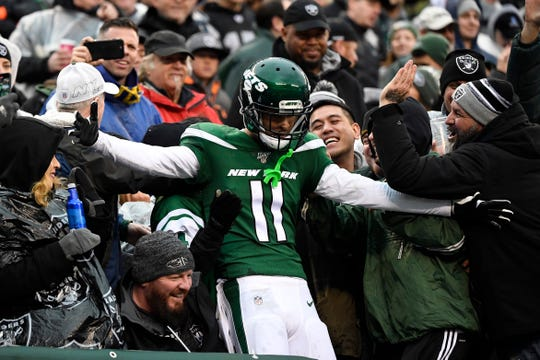 New York Jets wide receiver Robby Anderson (11) celebrates with fans after his touchdown against the Oakland Raiders in the second half. The Jets defeat the Raiders 34-3 at MetLife Stadium on Sunday, Nov. 24, 2019, on East Rutherford.