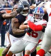 Nov 24, 2019; Chicago, IL, USA; New York Giants running back Saquon Barkley (26) rushes the ball against the Chicago Bears during the second half at Soldier Field. Mandatory Credit: Mike DiNovo-USA TODAY Sports