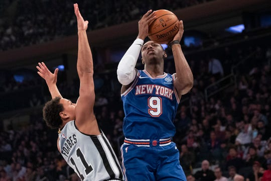 New York Knicks forward RJ Barrett (9) shoots against San Antonio Spurs guard Bryn Forbes (11) in the first half of an NBA basketball game, Saturday, Nov. 23, 2019, at Madison Square Garden in New York.