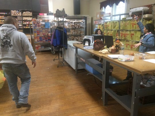 Volunteers helped sort food Sunday at St. Peter's Haven in Clifton. The meals will be distributed for Thanksgiving.