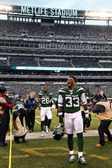New York Jets strong safety Jamal Adams (33) and Le'Veon Bell celebrate the win over the Oakland Raiders at MetLife Stadium on Sunday, Nov. 24, 2019, on East Rutherford.