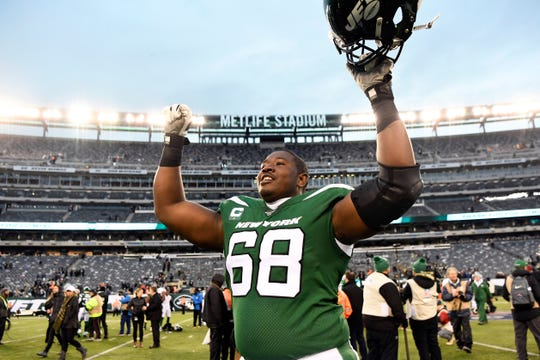 New York Jets offensive tackle Kelvin Beachum (68) celebrates a win over the Oakland Raiders at MetLife Stadium on Sunday, Nov. 24, 2019, on East Rutherford.