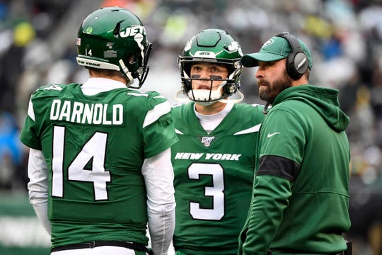 New York Jets head coach Adam Gase, far right, talks with quarterbacks Sam Darnold (14) and David Fales (3) during an Oakland Raider challenge in the first half of an NFL game at MetLife Stadium on Sunday, Nov. 24, 2019, on East Rutherford.