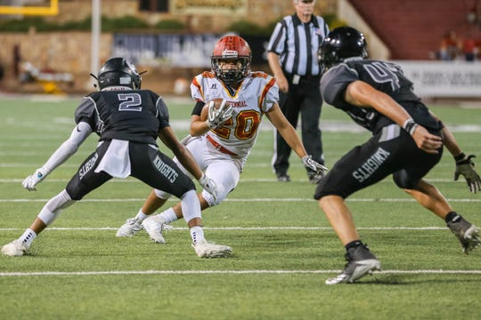 Senior running back Gabriel Acosta (20) runs the ball as the Centennial Hawks face off against the Oñate Knights at Aggie Memorial Stadium in Las Cruces on Saturday, Sept. 20, 2019.