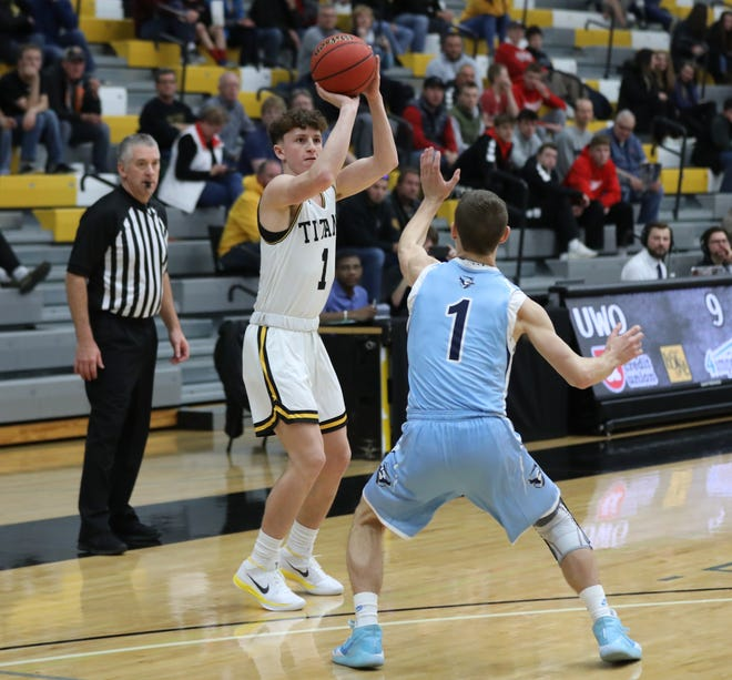 Freshman guard Will Mahoney shoots a 3-pointer during the UW-Oshkosh men's basketball home opener, a 97-92 loss to Elmhurst College.