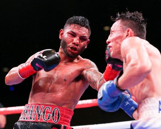 "Andrew ""El Chango"" Cancio of Blythe, Calif. lands a left jab versus Rene Alvarado in their WBA super featherweight championship bout on Saturday, Nov. 23, 2019 at Fantasy Springs Resort Casino in Indio, Calif."
