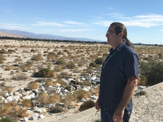 Sean Milanovich looks out over a wash beside tribal allottee land he owns off Gene Autry Trail in Palm Springs on Nov. 23, 2019. The land was passed down to him by his father, the late Richard Milanovich, former chairman of the Agua Caliente Band of Cahuilla Indians.