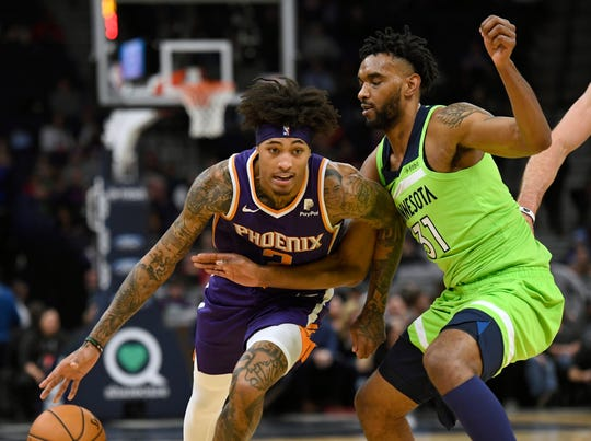 Minnesota Timberwolves forward Keita Bates-Diop (31) guards Phoenix Suns forward Kelly Oubre Jr. (3) during the second quarter of an NBA basketball game on Saturday, Nov. 23, 2019, in Minneapolis. (AP Photo/Hannah Foslien)