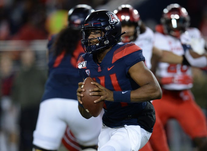 Nov 23, 2019; Tucson, AZ, USA; Arizona Wildcats quarterback Khalil Tate (14) runs the ball against the Utah Utes during the first half at Arizona Stadium. Mandatory Credit: Joe Camporeale-USA TODAY Sports