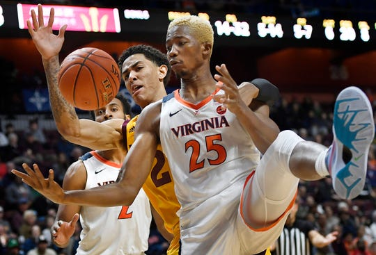 Arizona State's Jalen Graham and Virginia's Mamadi Diakite (25) fight for a rebound during the second half of a game Nov. 24.
