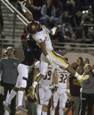 Salpointe's Bijan Robinson (5) makes a one handed catch against Chandler's Terry Byrd (29) during their Open Division semifinal game at Hamilton High School in Chandler, Saturday, Nov 23, 2019.