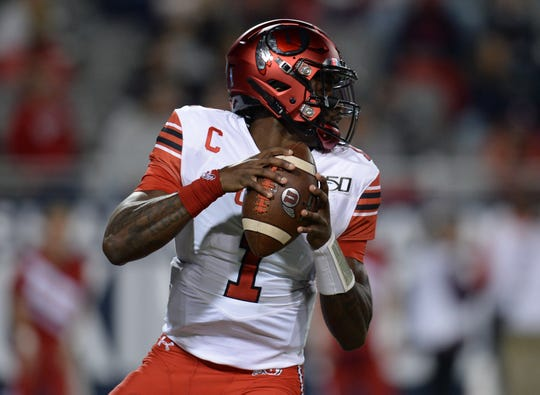 Nov 23, 2019; Tucson, AZ, USA; Utah Utes quarterback Tyler Huntley (1) drops back to pass against the Arizona Wildcats during the first half at Arizona Stadium. Mandatory Credit: Joe Camporeale-USA TODAY Sports
