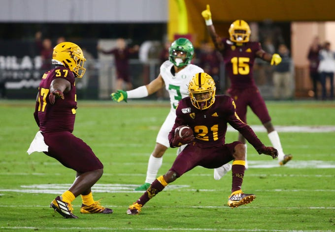 Arizona State Sun Devils defensive back Jack Jones (21) intercepts a pass against Oregon Ducks wide receiver Johnny Johnson III (3) in the second half during a game on Nov. 23, 2019 in Tempe, Ariz.