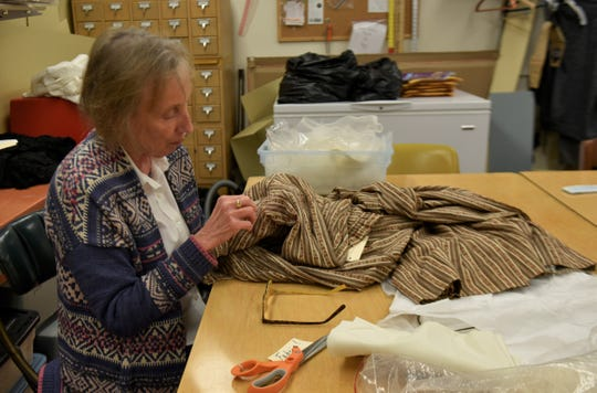 Joann Duningan has volunteered at Shippensburg University's Fashion Archives and Museum for three years helping to restore historical fabrics for display. The collection has been growing for over 30 years and features nearly 15,000 pieces of clothing, shoes and accessories.