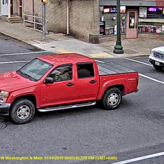 A school bus was stopped in front of 51 N. Main Street dropping children off.  While the stop lights were activated on the bus, the pictured red in color GMC Canyon illegally passed the school bus traveling south on Main Street, according to Chambersburg Police Department.