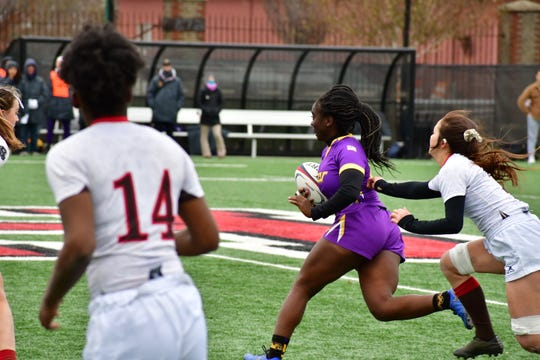 Juah Toe, center, runs with the ball during West Chester's victory over Brown in the national title.