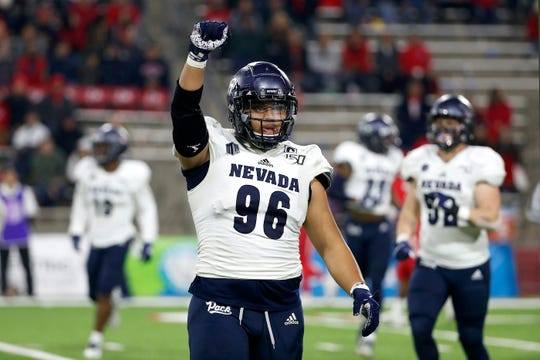 Nevada defensive tackle Hausia Sekona celebrates a key stop against Fresno State on Saturday night.