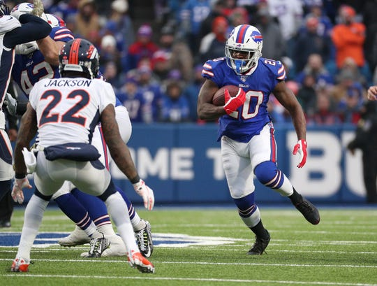 Bills running back Frank Gore finds running room against the Broncos.