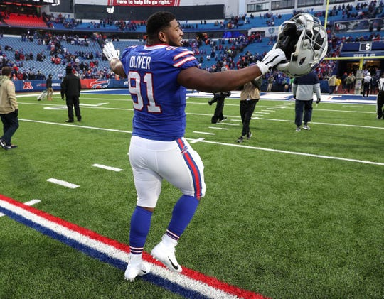 Bills Ed Oliver celebrates as he leaves the field after Buffalo's 20-3 win over Denver. Oliver had a sack in the win.