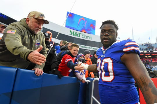 Defensive end Shaq Lawson (90) greets fans following the victory over the Denver Broncos at New Era Field.