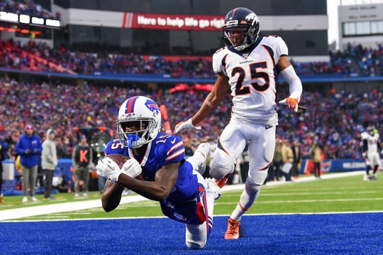 Buffalo Bills wide receiver John Brown (15) catches a pass for a touchdown as Denver Broncos cornerback Chris Harris (25) defends during a game earlier this season.