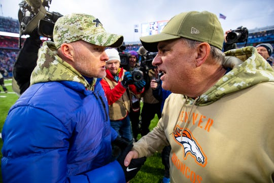 Head coach Sean McDermott of the Buffalo Bills shakes hands with head coach Vic Fangio of the Denver Broncos after the game at New Era Field on November 24, 2019 in Orchard Park, New York. Buffalo defeats Denver 20-3.