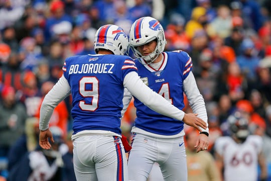 Buffalo Bills kicker Stephen Hauschka (4) celebrates with punter Corey Bojorquez (9) after kicking a field goal against the Denver Broncos during the first quarter of an NFL football game, Sunday, Nov. 24, 2019, in Orchard Park, N.Y. (AP Photo/John Munson)